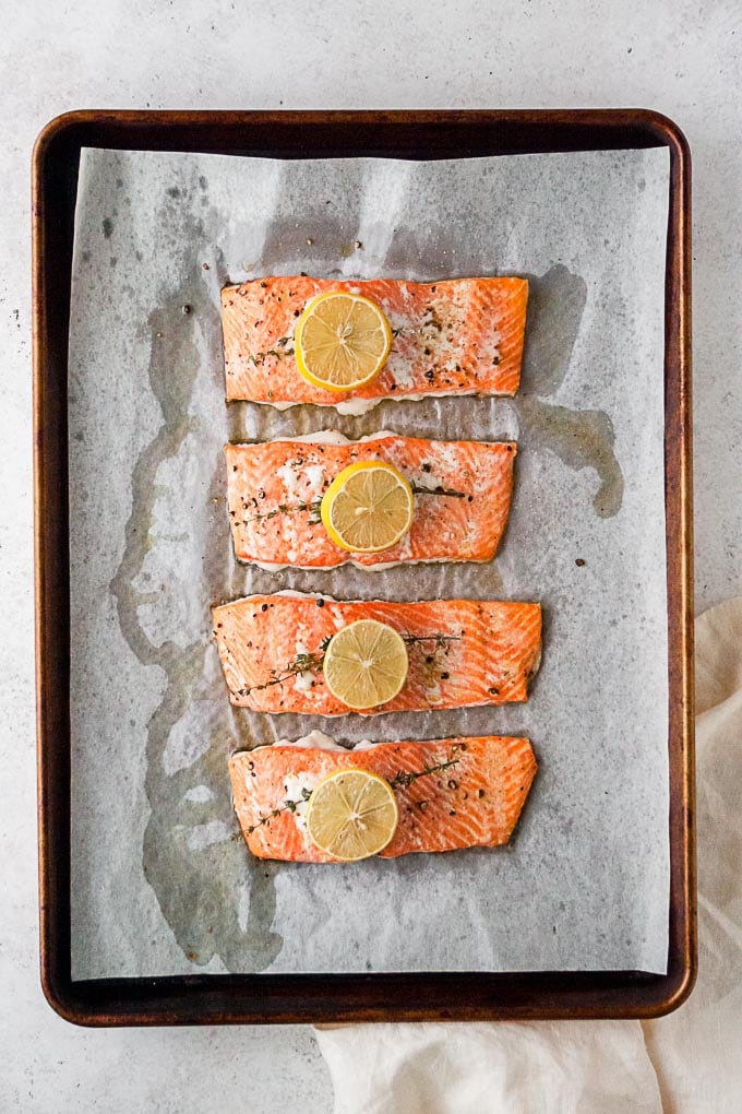 overhead shot of whole30 simple roasted lemon salmon recipe on a sheet pan